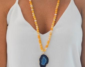 Yellow and White Jade beads with blue quartz