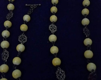 Yellow and bronze necklace and bracelet set