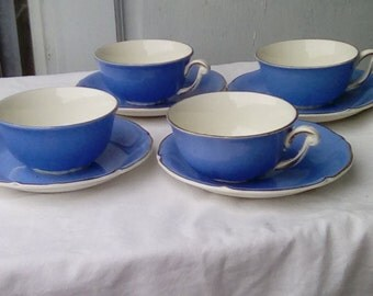 4 French coffee cups and saucers, semi porcelain demitasse cups.
