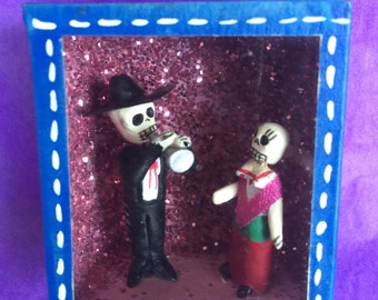 Day of the dead glass box with a male musician