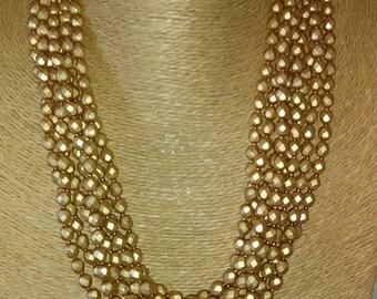 Multistrand Aztec Gold Czech Crystal Necklace, a true statement piece.