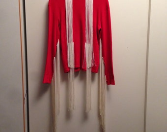 Red long sleeve t shirt with long white fringes