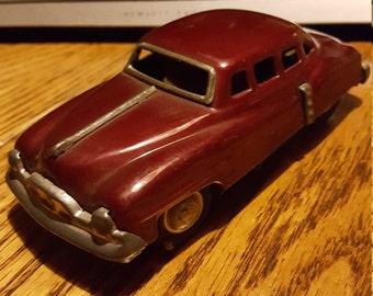 Small tin car.