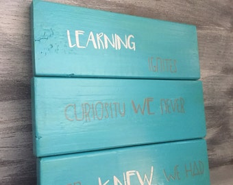 Learning ignites...wooden sign