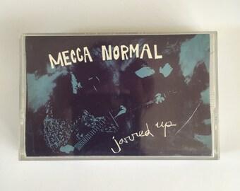 MECCA NORMAL - Jarred Up cassette (K)