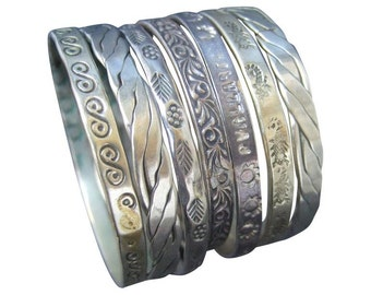 Wonderful Stack of Seven Sterling Bangles. 1960's.