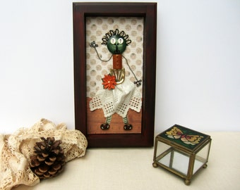 Single small figurines made of antique objects. wall decor, kids room.