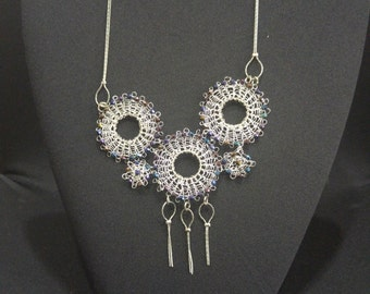 Knitted necklace with Swarovski beads