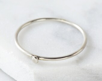 Silver stacking ring with tiny pebble detail