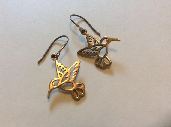 Delicate brass hummingbird earrings on hypoallergenic titanium earwires