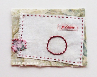 Textile art, mini quilt, stitching, Valentine, minimalist, Love, je t aime, circle of love