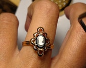 Vintage Mid Century Gold Lucite White Black Cameo Ring Signed Sarah Coventry Adjustable Lucite Resin Steampunk