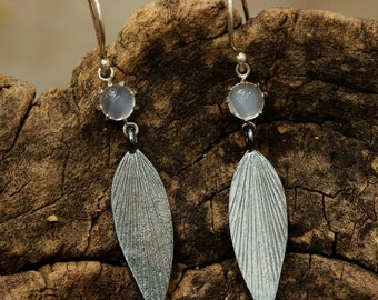 Moonstone earrings in silver prong setting with  sterling silver oxidized leaf and silver hooks