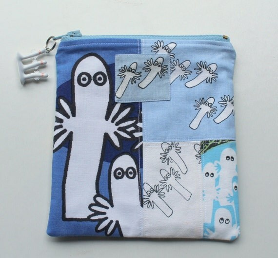 pretty zippered blue pouch and a charm with moomin