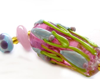 Long handmade lampwork pink cone decorated with flowers and leaves