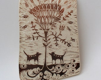 two dogs and the magic tree hand carved ceramic art tile