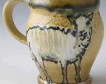 Mug with sheep slip trailed pottery
