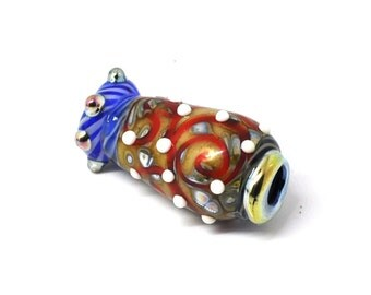 Ivory, brown, red and blue lampwork bead