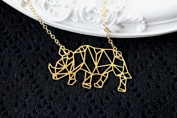 Golden rhino necklace fantasy filigree geometric