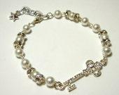 Rhinestone Key Bracelet - Sparkly rhinestone key charm with faux pearls and rhinestone accents
