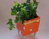 bright orange ceramic Planter with whimsical striped beetlejuice legs and polka-dots