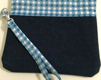 Blue and white dot with denim and orange ginkgo lining wristlet