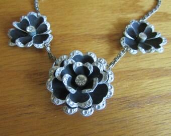 black silver flower bib