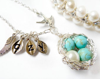 Bird Nest Necklace with Four Eggs, one Symbolize Miscarriage