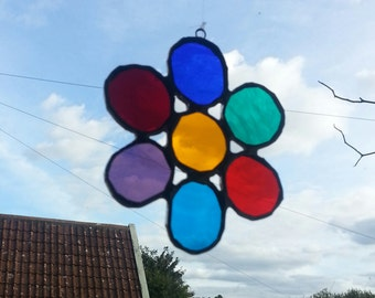 "Stained glass flower. 10 x 10cms/ 4 x 4 ""."