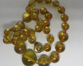A Vintage Graduated Lucite Bead Necklace in Translucent Yellow