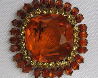 An Amber Rhinestone Brooch Made in Austria