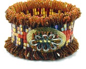 Brown, Orange, and Gold Beadwork Cuff with handmade Focal Button - Great Riches