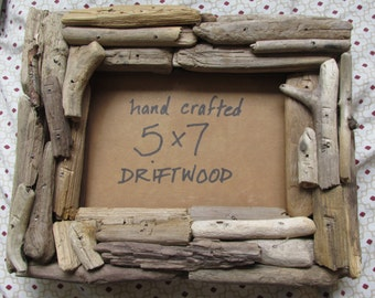 Driftwood frame for 5 by 7 inch hand crafted Lake Superior beach twigs with glass