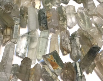Natural phantom quartz rock crystal points druzy type