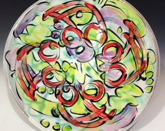 large serving / hanging bowl with lime green purple white and red music notes