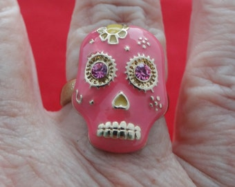 ADORABLE Vintage gold tone ring with pink sugar skull and rhinestones  in great condition, appears unworn Sizes available 7 & 8