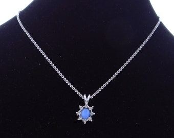 """Vintage 18"""" silver tone necklace with 1"""" rhinestone and faux blue star sapphire pendant in great condition, appears unworn"""