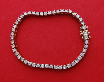 """Vintage gold tone 7.75"""" bracelet with shiny rhinestones in great condition"""