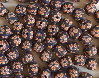 20 x 12mm polymer clay dark blue with yellow and orange flower cube beads