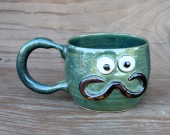 Teacup with Mustache. Handlebar Moustache Love Hipster Coffee Cup. Frosty Green Face Mug with Googly Eyes. Ceramic Stoneware Pottery.