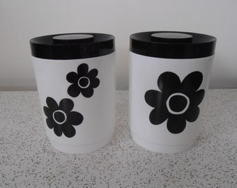 pair of black and white vintage kitchen canisters
