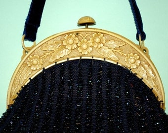 Edwardian Arts and Crafts beaded purse with molded celluloid frame