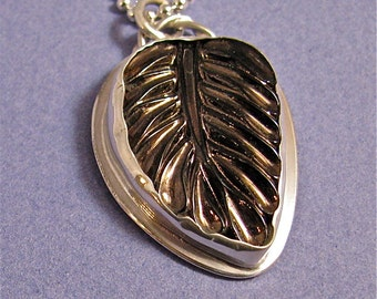Brown glass leaf sterling silver pendant