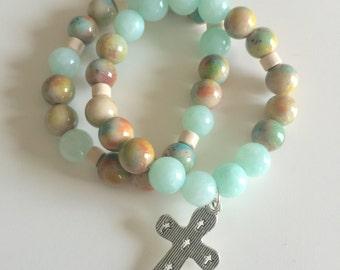Green, beige, bone, orange, red beaded, stackable bracelet set with cross charm