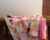 Baby girl quilt in pink, orange, and green