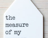 porcelain tag screenprinted text the measure of my success is my joy.