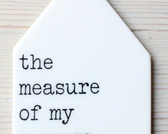 porcelain wall tag screenprinted text the measure of my success is my joy.