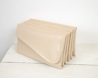 Set of six simple nude bridesmaid clutches