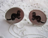 Vintage Pewter Oval Screw Back Earrings with Black Otter Design