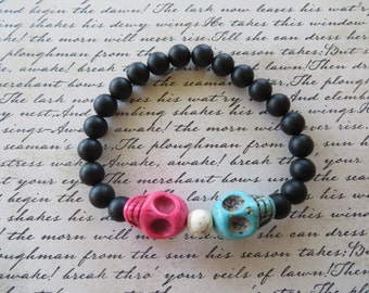 Blue And Pink Howlite Skulls With Matte Onyx Beaded Stretch Bracelet